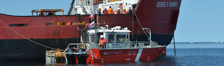 CCGS George R. Pearkes and a barge carry out operations on the Manolis L.