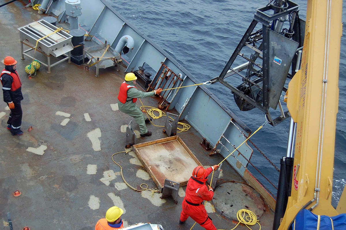Taking in the sediment grab on the deck. Photo Credit: Hilary Moors-Murphy