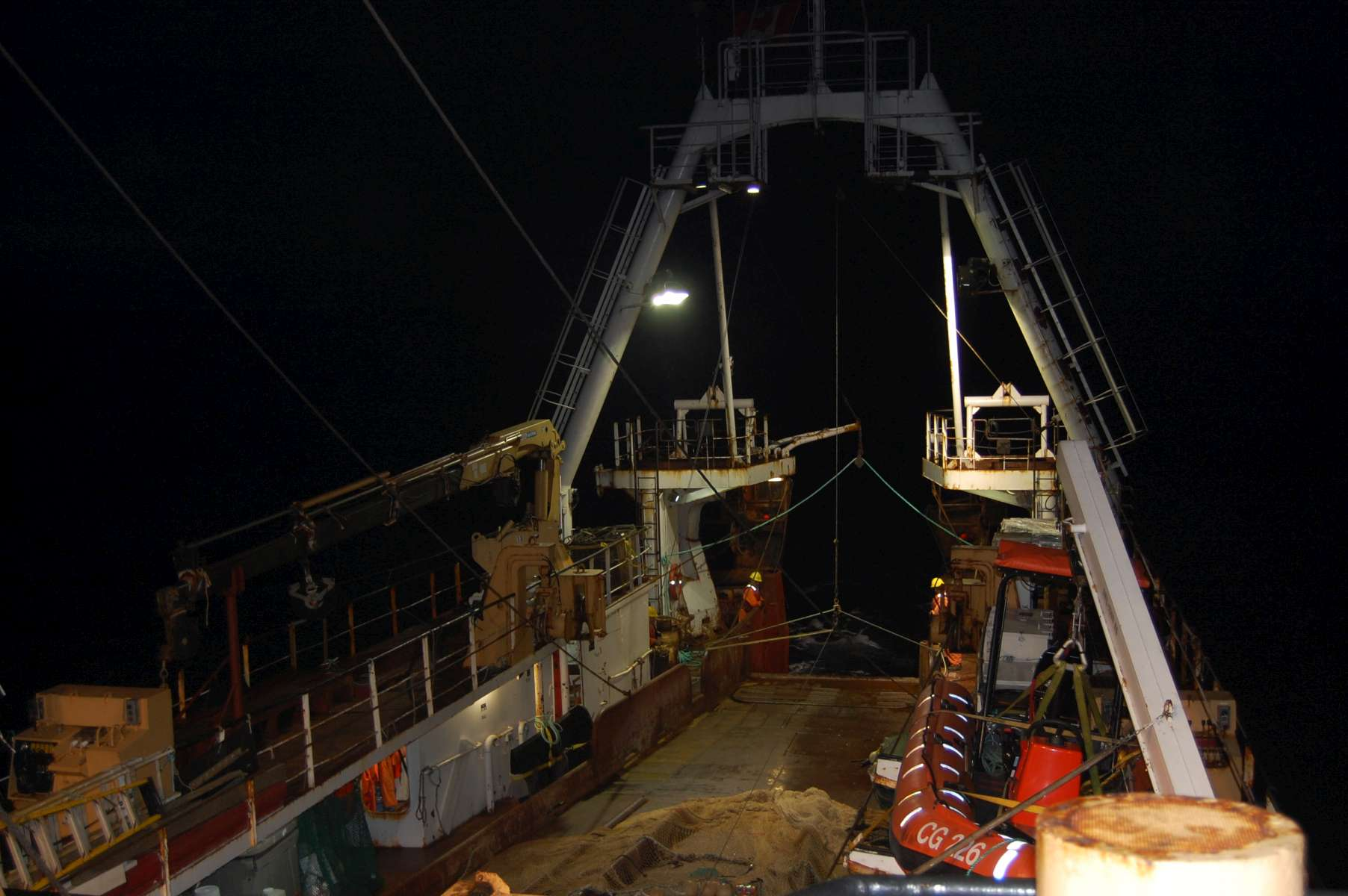 Ship pulling up a net from a Mesopelagic Tow at night. Photo Credit: Hilary Moors-Murphy