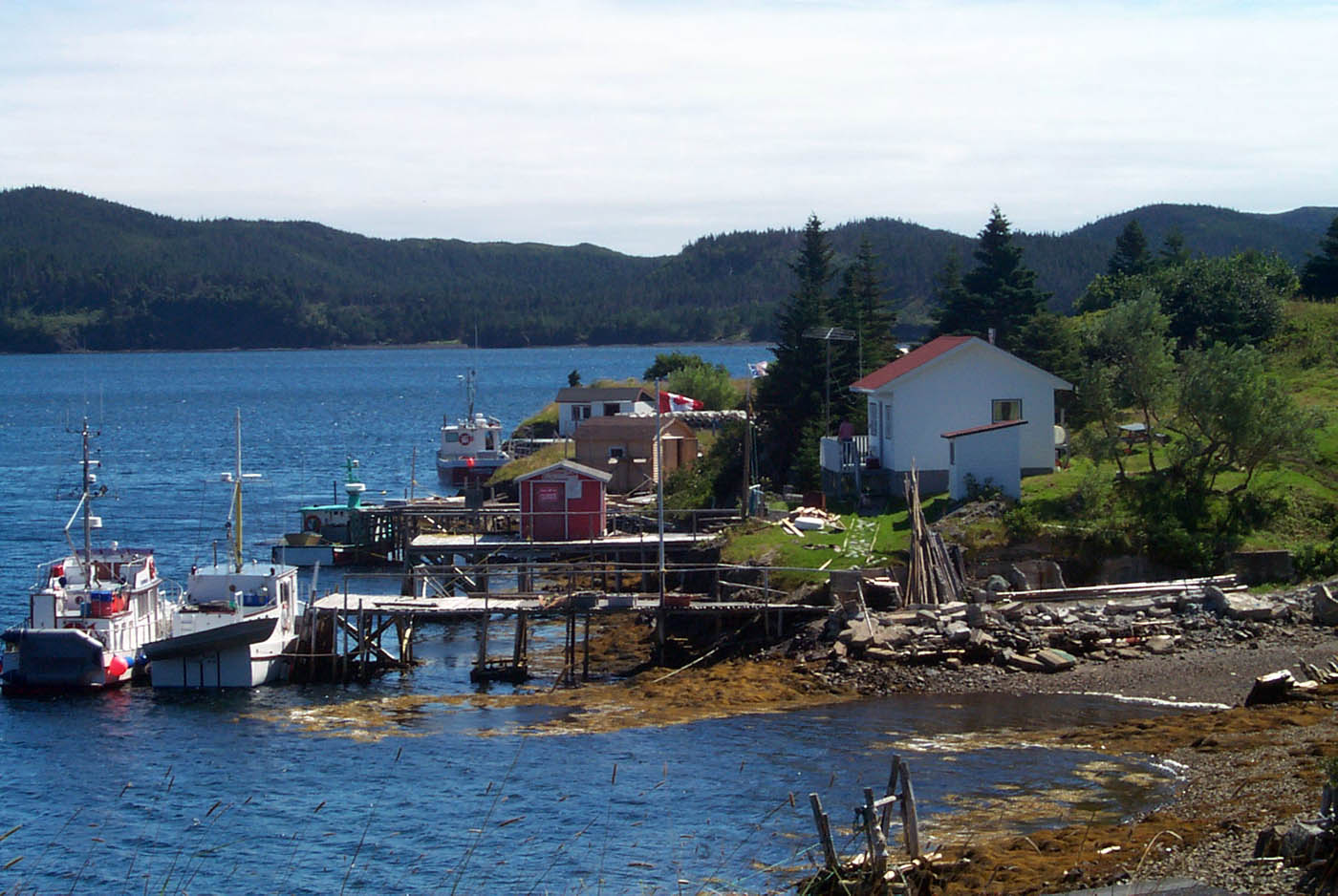 [Photo: Kingwell coastal house, dock, boats and water]