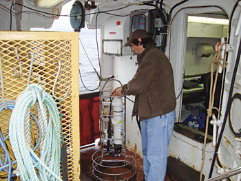 A conductivity, temperature, depth (CTD) instrument being prepared for deployment.