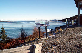 An information panel on the shoreline helps explain the Eastport Marine Protected Area to visitors.