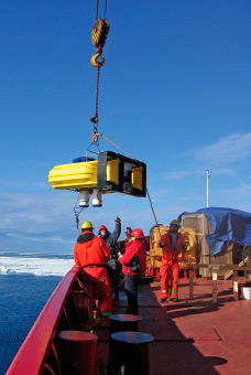One of the moorings to measure sea ice transport in Barrow Strait is deployed from the CCGS DesGroseilliers.